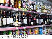 Купить «Shelves at beverage section of average Polish supermarket», фото № 16605539, снято 22 марта 2015 г. (c) Яков Филимонов / Фотобанк Лори