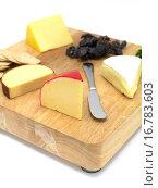 Купить «A selection of cheeses on a cutting board», фото № 16783603, снято 19 июля 2010 г. (c) easy Fotostock / Фотобанк Лори
