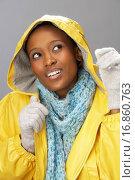 Купить «Young Woman Wearing Yellow Raincoat In Studio», фото № 16860763, снято 22 февраля 2020 г. (c) easy Fotostock / Фотобанк Лори