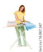 Купить «Portrait of young female ironing towels at home», фото № 16867347, снято 27 мая 2020 г. (c) easy Fotostock / Фотобанк Лори