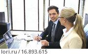 Купить «Young businessman in office», видеоролик № 16893615, снято 18 декабря 2015 г. (c) Raev Denis / Фотобанк Лори