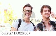 Купить «Smiling hipsters looking at the camera», видеоролик № 17020067, снято 19 августа 2019 г. (c) Wavebreak Media / Фотобанк Лори