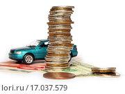 Купить «Покупка автомобиля. Монеты, евро, доллары и игрушечный автомобиль», эксклюзивное фото № 17037579, снято 22 декабря 2015 г. (c) Юрий Морозов / Фотобанк Лори