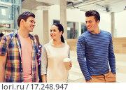Купить «group of smiling students with paper coffee cups», фото № 17248947, снято 7 сентября 2014 г. (c) Syda Productions / Фотобанк Лори