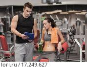Купить «smiling young woman with personal trainer in gym», фото № 17249627, снято 30 ноября 2014 г. (c) Syda Productions / Фотобанк Лори