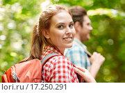 Купить «group of smiling friends with backpacks hiking», фото № 17250291, снято 25 июля 2015 г. (c) Syda Productions / Фотобанк Лори