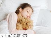 Купить «girl sleeping with teddy bear toy in bed at home», фото № 17251075, снято 6 декабря 2015 г. (c) Syda Productions / Фотобанк Лори