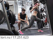 Купить «man and woman with barbell flexing muscles in gym», фото № 17251623, снято 30 ноября 2014 г. (c) Syda Productions / Фотобанк Лори