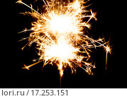 sparkler or bengal light burning over black. Стоковое фото, фотограф Syda Productions / Фотобанк Лори