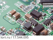 Купить «Компьютерная плата с чипом», фото № 17544095, снято 26 декабря 2015 г. (c) Алексей Букреев / Фотобанк Лори