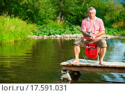 Купить «Photo of senior man fishing on weekend», фото № 17591031, снято 22 января 2019 г. (c) easy Fotostock / Фотобанк Лори