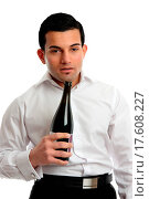 Alcohol abuse. A drunk man looking very uncoordinated and bleary eyed holding a bottle of wine. Alcohol affects the brain in the following ways, drowsiness... Стоковое фото, фотограф Stockbroker xtra / easy Fotostock / Фотобанк Лори