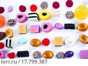 Купить «Many candy on white background.Fruit snacks», фото № 17799387, снято 23 октября 2018 г. (c) easy Fotostock / Фотобанк Лори