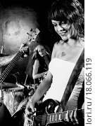 Купить «Female guitarist playing in her band», фото № 18066119, снято 21 января 2020 г. (c) easy Fotostock / Фотобанк Лори