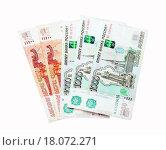 Купить «Российские рубли на белом фоне», фото № 18072271, снято 25 октября 2015 г. (c) Алёшина Оксана / Фотобанк Лори