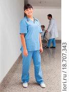 Купить «Smiling nurse ready to help in hospital corridor», фото № 18707343, снято 20 апреля 2019 г. (c) easy Fotostock / Фотобанк Лори