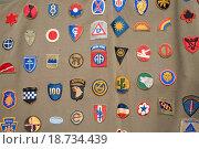 Купить «Detail of World War II army patches on side of tent at Mid_Atlantic Air Museum World War II Weekend and Reenactment in Reading, PA held June 18, 2008», фото № 18734439, снято 18 июня 2008 г. (c) easy Fotostock / Фотобанк Лори