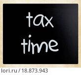 Купить «Tax time handwritten with white chalk on a blackboard», фото № 18873943, снято 19 ноября 2019 г. (c) easy Fotostock / Фотобанк Лори