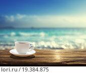 Купить «Море и чашка кофе», фото № 19384875, снято 26 октября 2011 г. (c) Iakov Kalinin / Фотобанк Лори
