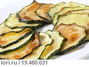 Купить «Roasted zucchini slices», фото № 19480031, снято 22 мая 2018 г. (c) PantherMedia / Фотобанк Лори