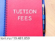 Купить «Tuition fees write on notebook», фото № 19481859, снято 7 августа 2020 г. (c) PantherMedia / Фотобанк Лори