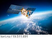 Купить «Space satellite over the planet earth», фото № 19511691, снято 9 февраля 2013 г. (c) Андрей Армягов / Фотобанк Лори