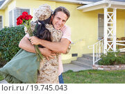 Купить «Husband Welcoming Wife Home On Army Leave», фото № 19745043, снято 29 октября 2012 г. (c) easy Fotostock / Фотобанк Лори