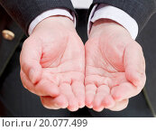 businessman holding empty handful from two palms. Стоковое фото, фотограф Zoonar/Valery Voenny / easy Fotostock / Фотобанк Лори
