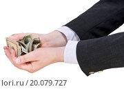pile of dollars banknotes in businessman handful. Стоковое фото, фотограф Zoonar/Valery Voenny / easy Fotostock / Фотобанк Лори