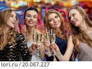 Купить «happy women with champagne glasses over lights», фото № 20087227, снято 21 ноября 2015 г. (c) Syda Productions / Фотобанк Лори