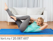 Купить «woman exercising on mat at home», фото № 20087607, снято 27 ноября 2015 г. (c) Syda Productions / Фотобанк Лори