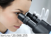 Купить «close up of scientist looking to microscope in lab», фото № 20088255, снято 4 декабря 2014 г. (c) Syda Productions / Фотобанк Лори