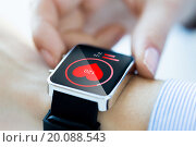 Купить «close up of hands with heart icon on smartwatch», фото № 20088543, снято 13 августа 2015 г. (c) Syda Productions / Фотобанк Лори