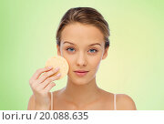 Купить «young woman cleaning face with exfoliating sponge», фото № 20088635, снято 31 октября 2015 г. (c) Syda Productions / Фотобанк Лори