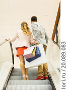 Купить «happy young couple with shopping bags in mall», фото № 20089083, снято 10 ноября 2014 г. (c) Syda Productions / Фотобанк Лори