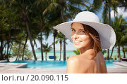 Купить «happy young woman in sunhat over hotel beach», фото № 20090115, снято 11 июля 2013 г. (c) Syda Productions / Фотобанк Лори