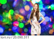 Купить «happy young woman or teen girl over disco lights», фото № 20090311, снято 31 октября 2015 г. (c) Syda Productions / Фотобанк Лори