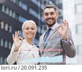 Купить «smiling businessmen standing over office building», фото № 20091235, снято 19 августа 2014 г. (c) Syda Productions / Фотобанк Лори