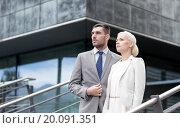 Купить «serious businessmen standing over office building», фото № 20091351, снято 19 августа 2014 г. (c) Syda Productions / Фотобанк Лори