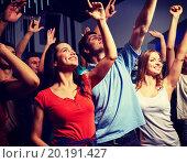 Купить «smiling friends at concert in club», фото № 20191427, снято 20 октября 2014 г. (c) Syda Productions / Фотобанк Лори