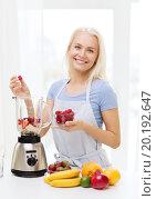 Купить «smiling woman with blender preparing shake at home», фото № 20192647, снято 26 апреля 2015 г. (c) Syda Productions / Фотобанк Лори