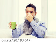 Купить «ill man with flu drinking tea and blowing nose», фото № 20193647, снято 29 января 2015 г. (c) Syda Productions / Фотобанк Лори