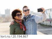 Купить «happy teenage friends in shades taking selfie», фото № 20194867, снято 19 марта 2015 г. (c) Syda Productions / Фотобанк Лори
