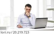 Купить «busy businessman with laptop and papers in office», видеоролик № 20219723, снято 9 июля 2015 г. (c) Syda Productions / Фотобанк Лори