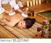 Купить «Young woman getting massage in bamboo spa.», фото № 20227063, снято 17 мая 2011 г. (c) easy Fotostock / Фотобанк Лори