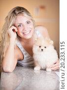 Купить «young woman playing with her tinny dog at home», фото № 20233115, снято 12 августа 2012 г. (c) easy Fotostock / Фотобанк Лори