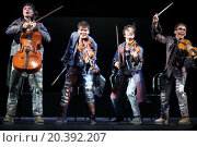 Купить «MOSCOW - MAR 12, 2014: Four cheerful men Taper-show: dancing on the strings in costumes with musical instruments on stage of the Palace on Yauza», фото № 20392207, снято 12 марта 2014 г. (c) Losevsky Pavel / Фотобанк Лори