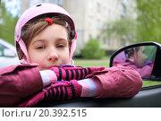 Купить «Girl in pink helmet leaning on the open window in the car», фото № 20392515, снято 3 мая 2014 г. (c) Losevsky Pavel / Фотобанк Лори