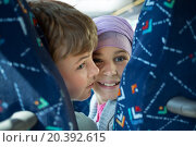 Купить «Two children are sitting in bus and turning back.», фото № 20392615, снято 6 сентября 2014 г. (c) Losevsky Pavel / Фотобанк Лори