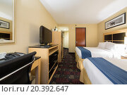 Купить «USA, NEW-YORK - 07 SEP, 2014: Small stylish bedroom with two beds and TV in Holiday Inn Express, Wall Street.», фото № 20392647, снято 7 сентября 2014 г. (c) Losevsky Pavel / Фотобанк Лори